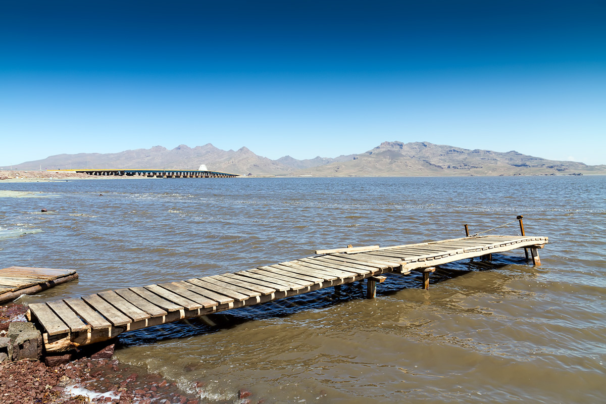 The wooden pier at Lake Urmia used by local fishermen mostly.The wooden pier at Lake Urmia used by local fishermen mostly. In the backdrop there is the bridge carrying the highway between cities of Urmia and Tabriz.