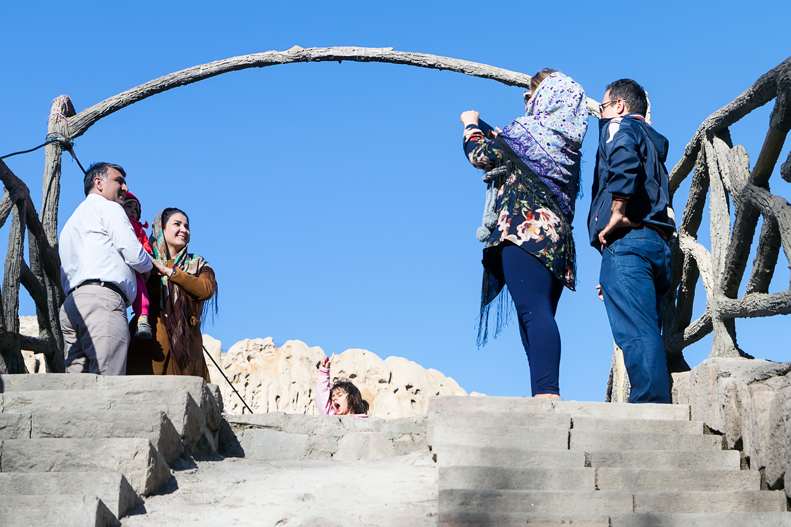 A walk-over bridge under the village of Kandovan is a popular place for memorial photos.