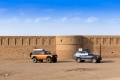 Our cars in front of Maranjab Caravanserai