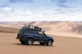 Our Landcruiser in the Lut desert in Iran, among proper dunes