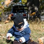 The child - youngest expedition member - among the falling leaves at Ramsko jezero (lake), BiH