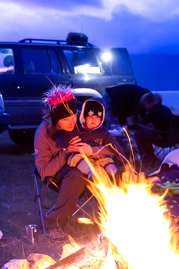 Enjoying the evening campfire in the bivouac, fire helping to fight off the cold.