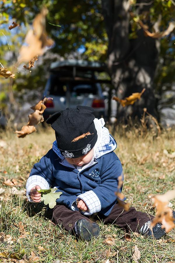 The child among the falling leaves at Ramsko jezero (lake), BiH