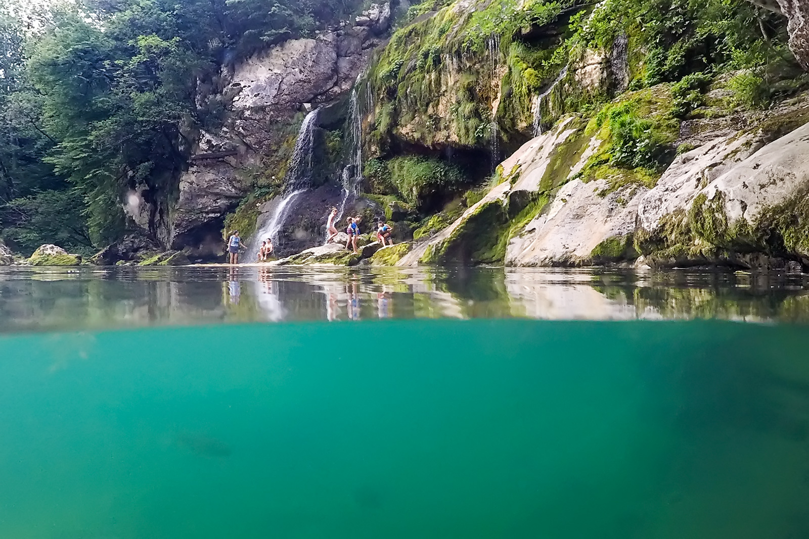The waters of the pools under Virje waterfall are  quite murky  - a result of numerous swimmers seeking  to chill themselves in the summer heat. But you can still see a trout here and there.
