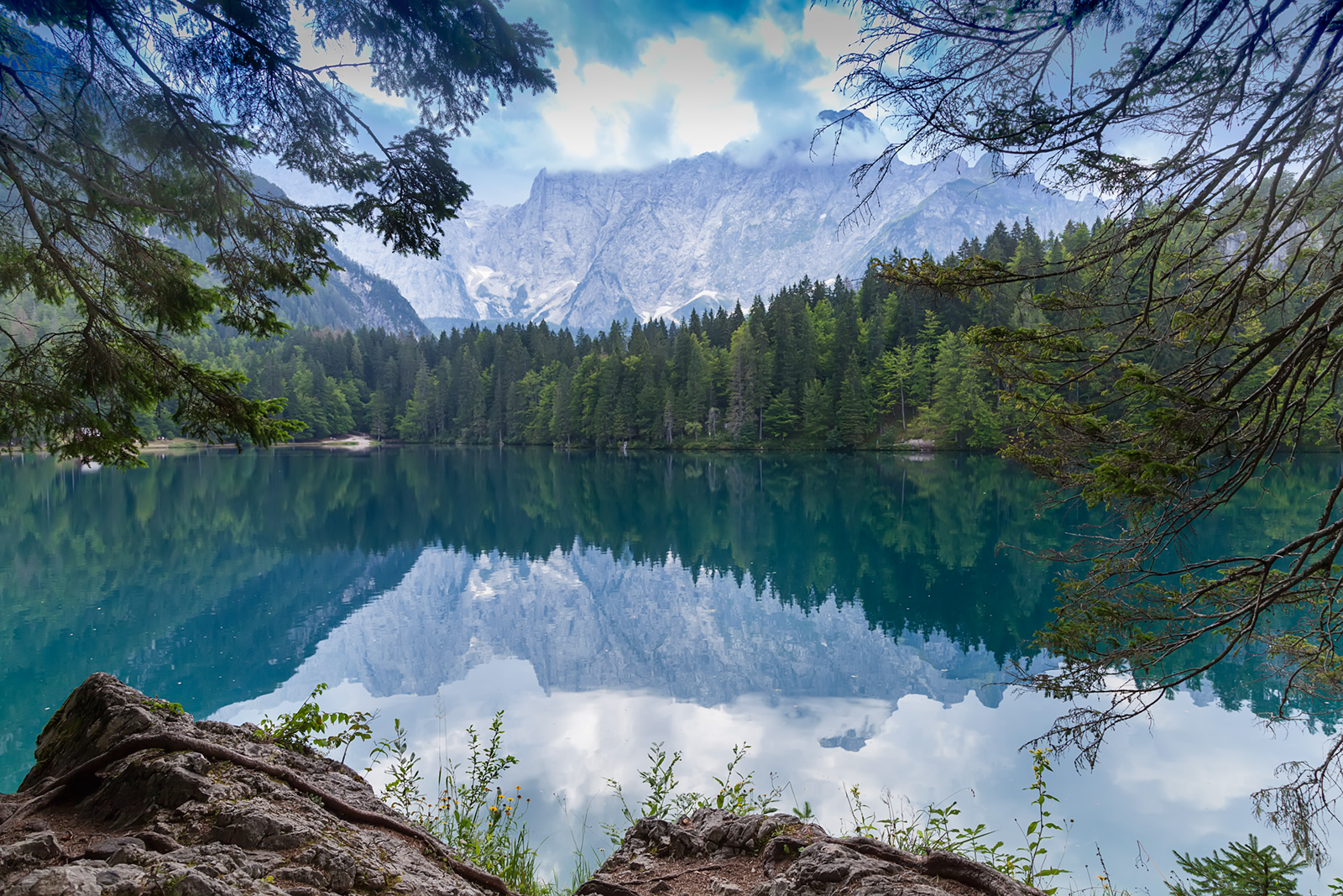 The lower Belopeško lake (Laghi di Fusine in italian) with magnificient Mangart mountain massif in the backdrop offers good opportunities for a snapshot.