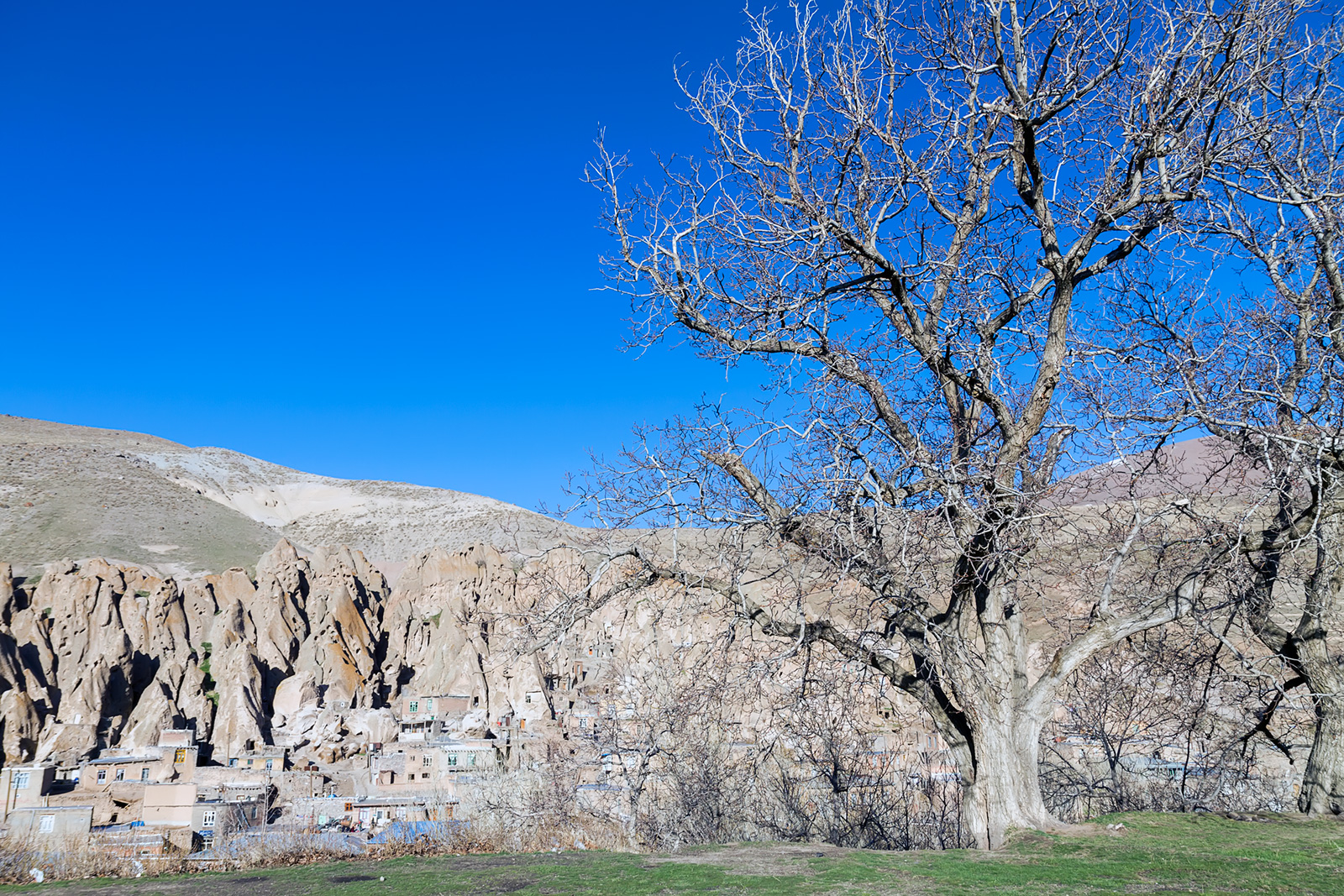 Village of Kandovan high from the opposite valley ridge. Walnut trees are frequent in the Azerbaijan provinces of Iran.