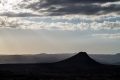 The peak of the Zendan-e Soleyman in the setting sun, photographed from the site of Takht-e Soleyman. The volcanic peak rises more than a 100 meters above the surrounding land and reaches around 2.300m ASL.