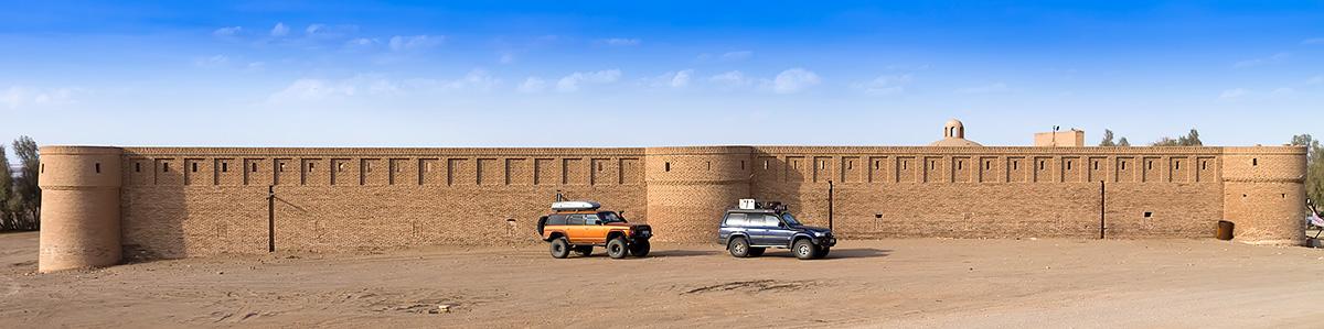 Our cars in front of Maranjab Caravanserai
