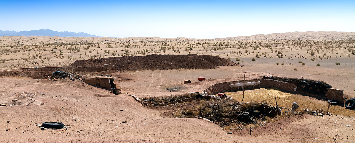 A farm hidden in and behind a hill on the eastern plains of Maranjab.