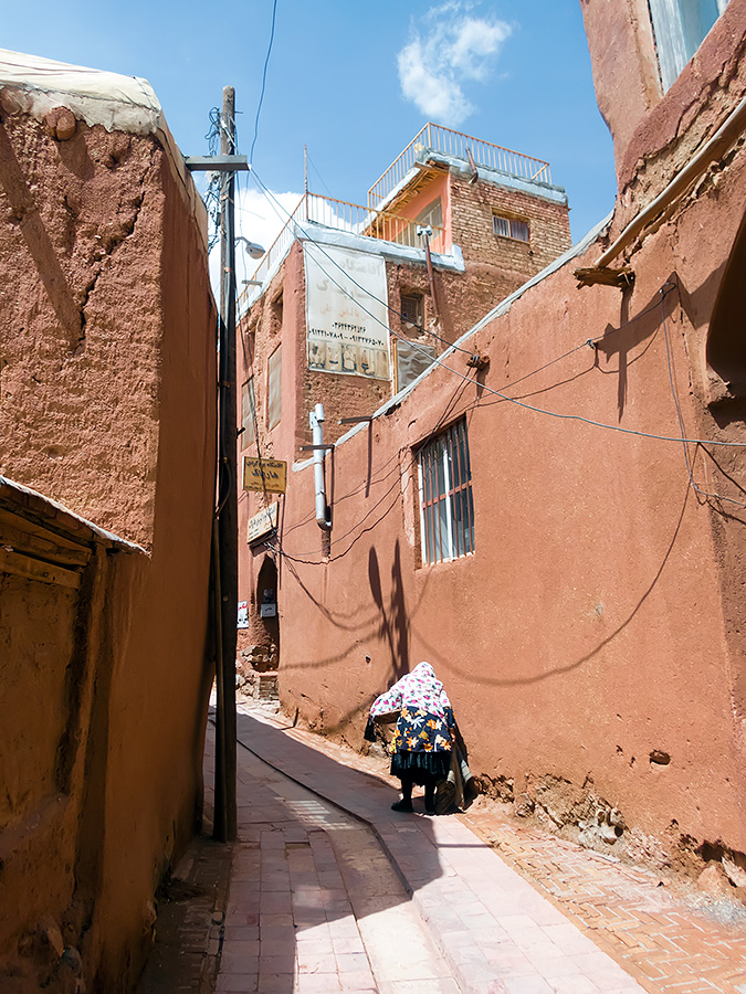 A detail from Abyaneh with Abyanaki woman in traditional costume.