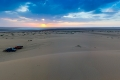 The panoramic view of our bivouac at the edge of the desert. The Namak Lake reflects the rays of setting sun.