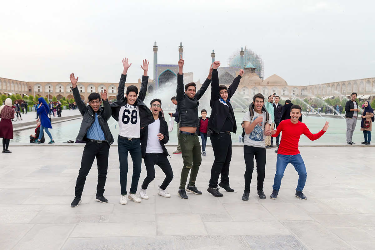 The youngsters in Esfahan, using their basic knowledge of English, asked me if I can take a photo of them. At first they were quite rigid and weren\'t sure what I want, but soon they were jumping in front of my lens. I sent them the picture and they were really happy about it.