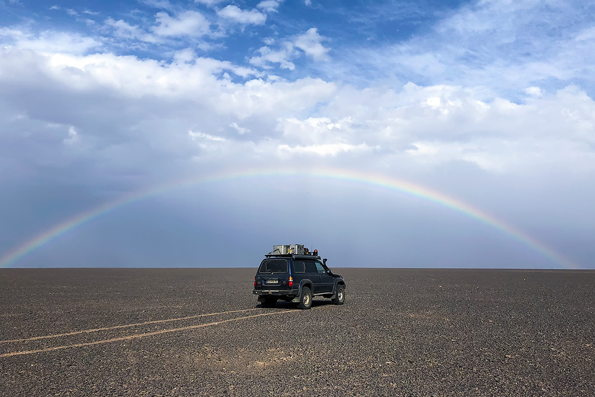 The clouds and the coming cold weather front attributed to some stunning pictures on otherwise bare gravel plain. On our way to Rig-e Yalan