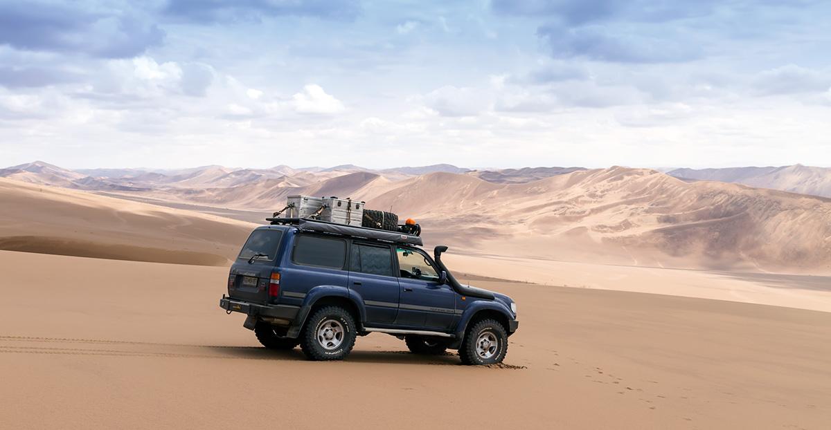 Our Landcruiser in the Lut desert in Iran, among proper dunes