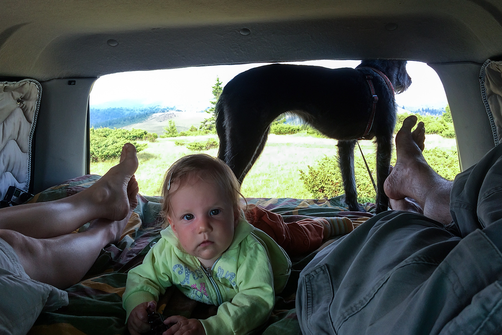 Afternoon rest on the bed in our Land Cruiser. Carpathian mountains, Romania.