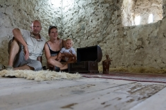 The family in the tower of Theth, Albania.