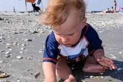 Kea Pika collecting her first sea shell at Corbu beach, Romania.